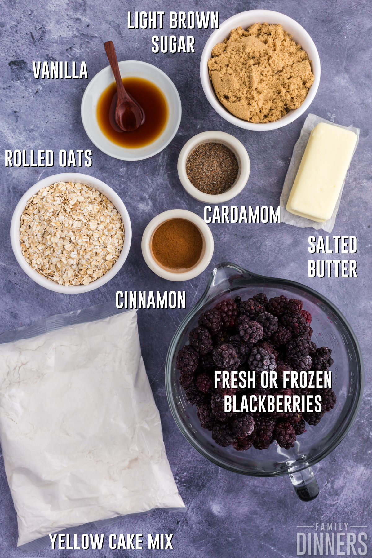 dark gray countertop with bowls of ingredients for blackberry dump cake