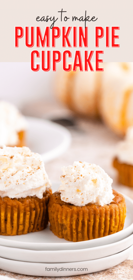 Two pumpkin pie cupcakes on a stack of three plates. Little pies have whipped cream on top.