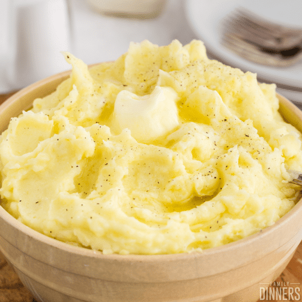 bowl of creamy mashed potatoes with butter on top