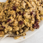 plate of bread stuffing with cranberries