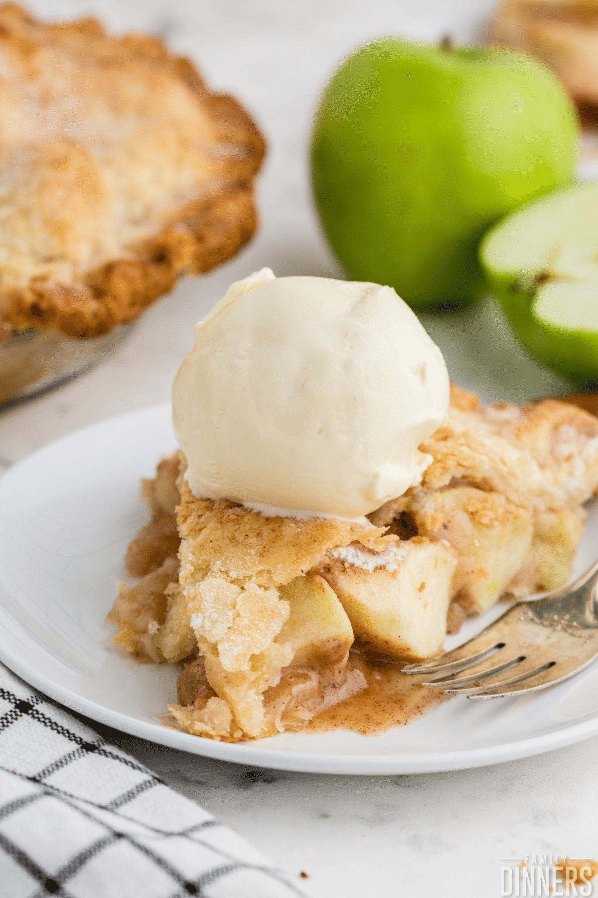 slice of  pie with vanilla ice cream scoop