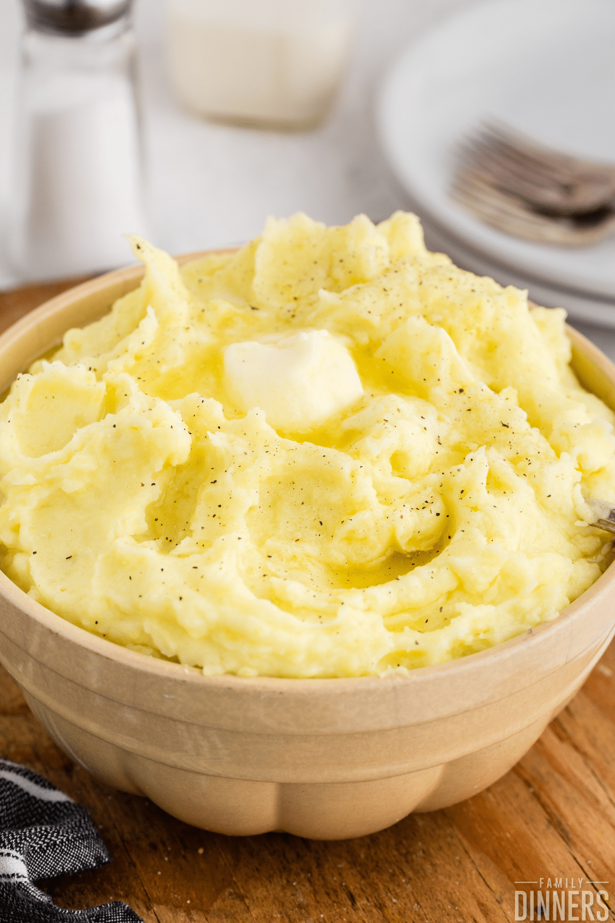 Thanksgiving food - mashed potatoes with butter on top in a bowl for serving potato side dish