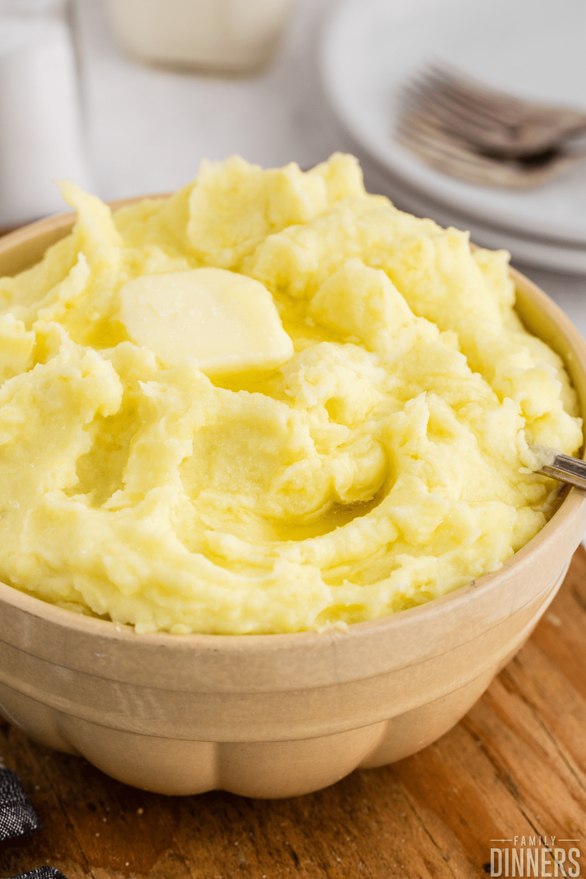 bowl of mashed potatoes with butter on top