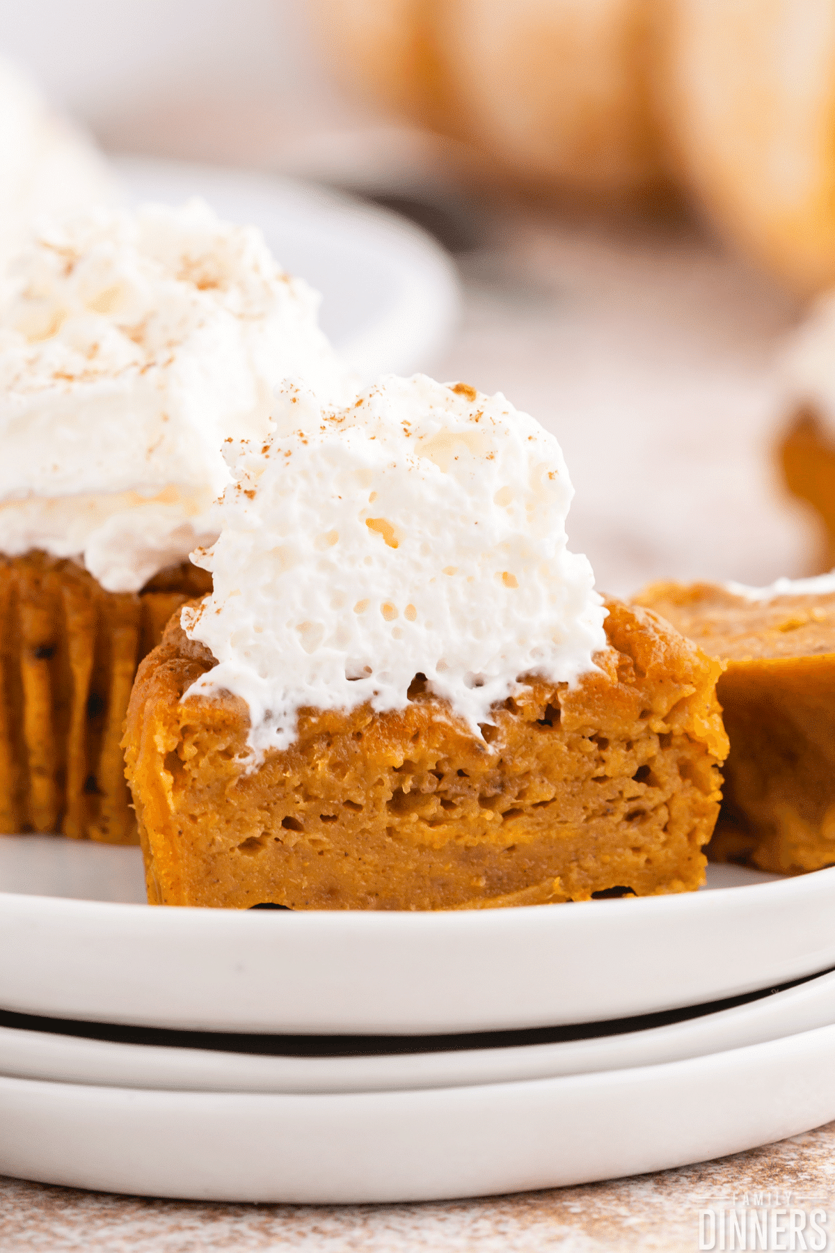 pumpkin pie cupcakes on white plates