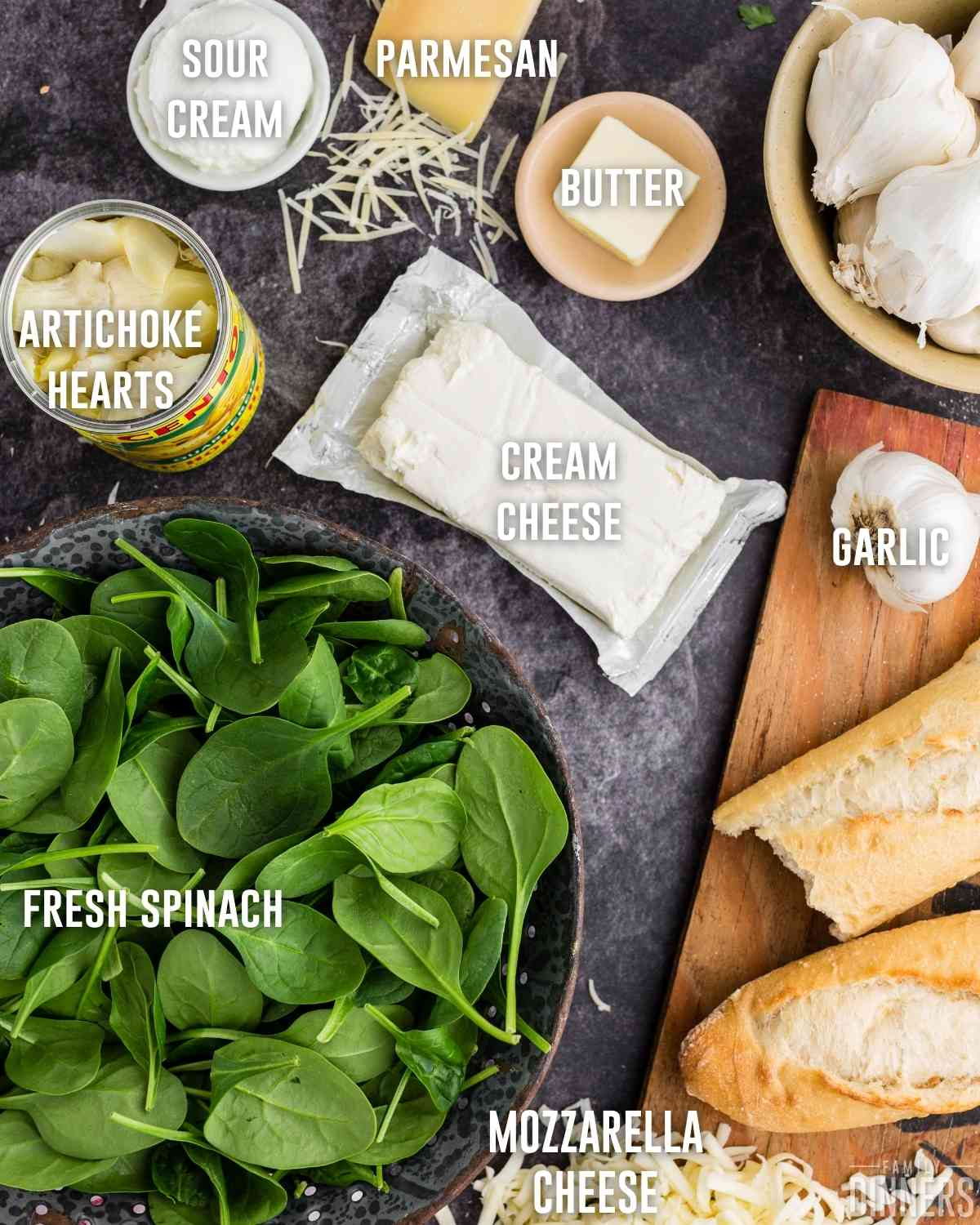 cheesy hot spinach dip with artichokes ingredients including cream cheese, mozzarella, parmesan, sour cream, butter, fresh spinach and garlic