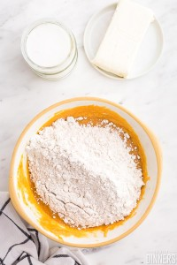 mixing bowl with flour mixture on top of pumpkin mixture